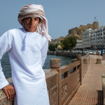 Young arab man standing on the shoreline